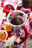 Mulled wine with spices and gingerbread cookies. Stock Photo