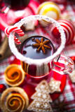 Mulled wine with spices and gingerbread cookies. Royalty Free Stock Image
