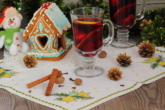 Mulled wine with spices and gingerbread house. Christmas composition with hot spiced wine stock photography
