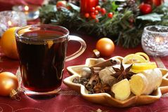 Mulled wine. And spices on holiday plate Stock Photos