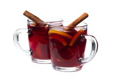 Mulled wine with spices isolated on white background stock photo