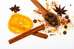Mulled wine spices kit. Spices kit for preparing mulled wine or hot beverage, close up. Spoon with spices, dried orange stock photography