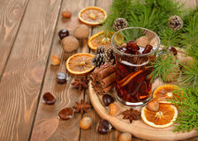 Mulled wine, spices and nuts Stock Photos