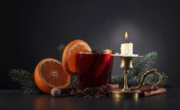 Mulled wine with spices and orange . Royalty Free Stock Photos