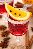 Mulled wine with spices and orange slices Stock Photos