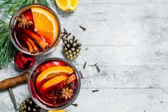 Mulled wine with spices and orange slices stock image