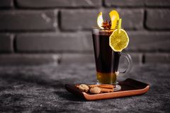 Mulled wine and spices on stone background. royalty free stock photos