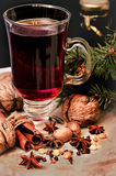 Mulled wine, spices and walnuts Royalty Free Stock Photo