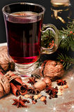 Mulled wine, spices and walnuts Royalty Free Stock Image