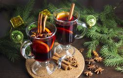 Mulled wine with spices-winter hot drinks. Star anise, cinnamon. stock photos