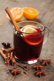 Mulled wine. And spices on wooden background Royalty Free Stock Photo