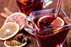 Mulled wine. And spices on wooden background stock photo