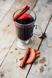 Mulled wine and spices on wooden background. Food photo. Fall. Selective focus. Romantic vintage style royalty free stock image