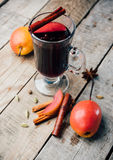 Mulled wine and spices on wooden background. Food photo. Fall. Selective focus. Romantic vintage style royalty free stock photography