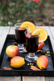 Mulled wine and spices on wooden background Stock Photo
