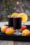 Mulled wine and spices on wooden background Stock Photography
