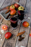 Mulled wine and spices on wooden background Royalty Free Stock Photography