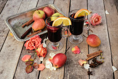 Mulled wine and spices on wooden background Stock Images