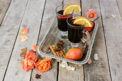 Mulled wine and spices on wooden background Stock Image