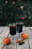 Mulled wine and spices on wooden background Royalty Free Stock Image