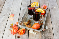 Mulled wine and spices on wooden background Stock Photos