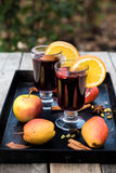 Mulled wine and spices on wooden background. Royalty Free Stock Photos