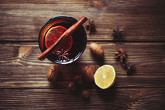 Mulled wine and spices on wooden background. Selective focus. Mulled wine and spices on wooden background Royalty Free Stock Photos