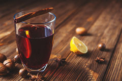 Mulled wine and spices on wooden background. Selective focus. Mulled wine with cinnamon and lemon Stock Image