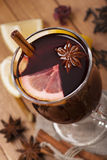 Mulled wine  with star anise and cinnamon. Mulled wine with citrus and herbs Royalty Free Stock Photography