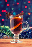 Mulled wine with tinsel on a wooden table on bokeh background Royalty Free Stock Photography