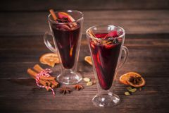Mulled wine with fruits, cinnamon sticks, anise and decorations Royalty Free Stock Image