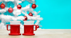 Mulled wine. Two glass of hot mulled wine on the table, white christmas tree and turquoise background - copy space Royalty Free Stock Photo