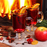 Mulled wine - two glasses on the background of a burning firepla Stock Photography