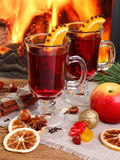 Mulled wine - two glasses on the background of a burning firepla Stock Photo