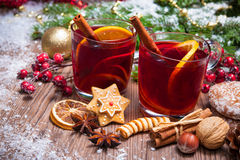 Mulled wine. Two glasses of mulled wine with christmas decoration royalty free stock photo