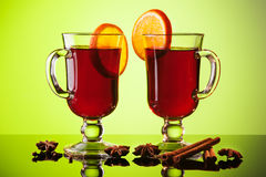 Mulled wine in two glasses on green Royalty Free Stock Images
