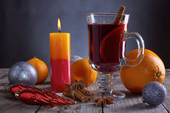 Mulled wine vith candle, oranges, spices and christmas decoration Stock Photo