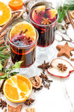 Mulled wine white background Hot winter cocktail fruits spices Royalty Free Stock Photography