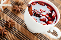 Mulled wine in a white cup and star anise Royalty Free Stock Photo