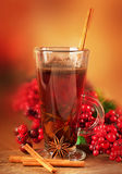 Mulled wine from wine. And cinnamon, a Christmas branch of berries Royalty Free Stock Photos