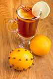 Mulled wine for winter and Christmas with  spices and orange Royalty Free Stock Photo