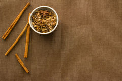 Mulling Spices. Overhead view of a bowl of mulling spices and cinnamon sticks Royalty Free Stock Photography