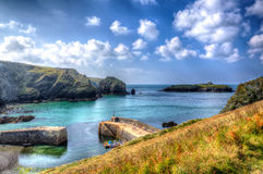 Mullion Cove harbour Lizard peninsula south Cornwall UK in colourful bright HDR Stock Photos