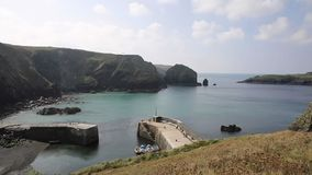 Mullion Cove harbour Lizard peninsula south Cornwall UK PAN stock video footage