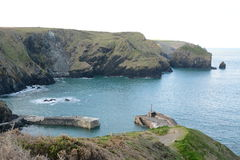 Mullion Cove Port Cornwall UK. View into Mullion Cove port from the cliffs above Stock Photos