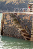 Mullion harbour wall steps down to sea-level Royalty Free Stock Image