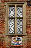 Mullioned Window. Medieval Mullioned Window and Coat of Arms Royalty Free Stock Images