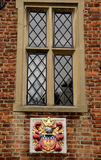 Mullioned Window. Medieval Mullioned Window and Coat of Arms Stock Photo