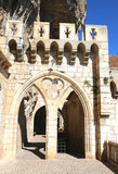 Mullioned window and arch in episcopal city of Rocamadour, France Royalty Free Stock Image