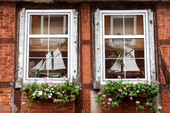 Mullioned windows in an old half timbered house Stock Image